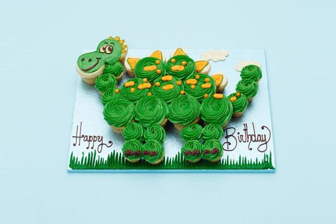 Silver Dinosaurs On Wedding Cake